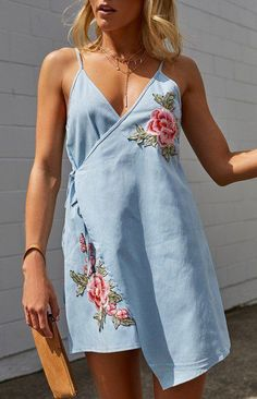 This spring, try a denim slip dress with rose embroidery. Let Daily Dress Me help you find the perfect outfit for whatever the weather! dailydressme.com/
