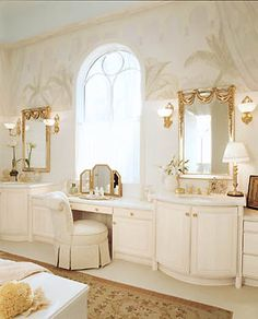 Master bathroom with double vanities separated by a makeup table...Diva Status...lol :)