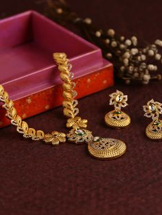Buy DHRUVI by Zaveri Pearls Gold-Toned Embellished Jewellery Set online in India at best price.Gold -toned embellished jewellery set consists of a necklace and a pair of earrings Gold-toned embellished Gold Wedding Jewelry, Gold Jewelry Simple, Bridal Jewelry, Silver Jewelry, Quartz Jewelry, Simple Necklace, Silver Earrings, Gold Bangles Design, Gold Earrings Designs