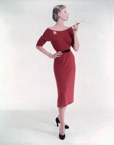 1950  Model is wearing a red knit dress with a bateau neckline and push-up sleeves by Joseph Guttman.  Image by Condé Nast Archive/CORBIS