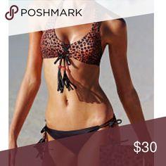 ❌Price Firm❌VS Reversible Lace Up Halter 🌺 ❌NO Offers❌VS Reversible Lace Up Halter Black Happy Cheetah Top. NWT. Size: S Victoria's Secret Swim Bikinis