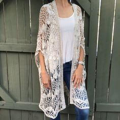 Hem & Thread cream crochet long cardigan! Hem & Thread beautiful cream long crochet cardigan! One size fits all. 100 % acrylic. Very soft. Can be worn open or closed in front. Length from center of back to bottom 38.5 inches. Bundle and save! Hem & Thread Tops