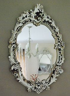 I've bought TWO rococo mirrors from Goodwill that I plan to paint in bold colors and hang in the bathrooms.