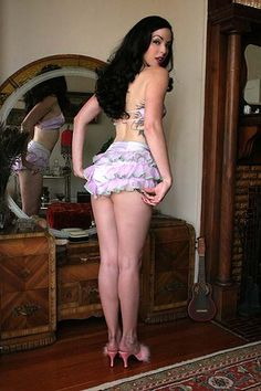 This authentic vintage dancer's costume was worn by performers of a Seattle burlesque hall in the 1920s. It is the real deal, complete with glittering rhinestones and chiffon ruffles! The halter bra…