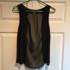 Merona dressy tank Black and green Merona tank. Polyester. The green part on front is shinier compared to black part. Back is plain. Merona Tops Tank Tops