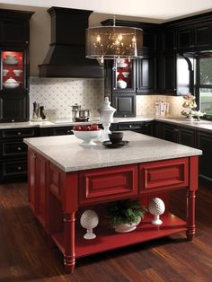 Black cabinets effectively fade into the background to show off the red island at center, while a light backsplash and countertops keep the painted pieces from feeling heavy. For a similar look, try: Red Gumball (red) and Phantom Mist (black), Olympic Kitchen Cabinet Colors, Home Kitchens, Kitchen Remodel, Kitchen Design, Red Kitchen, Painting Kitchen Cabinets, New Kitchen, New Kitchen Cabinets, Kitchen Redo