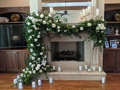 Wow florals and greenery for a large mantel as backdrop for musicians at home wedding.  Using roses, lilies, garden roses and mainly ruscus greenery.