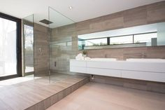 Loving the long sleek lines of this bathroom. This is a two-story modern residence is situated on a wooded lot in Oakville, Ontario, Canada designed by architect Guido Costantino. This modern home is comprised of a monochromatic palate of stucco, concrete, brick, anodized siding and a mix of opaque and transparent glass