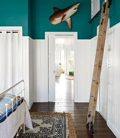 Great storage tip: Don't waste space! Use pocket doors in small rooms, and add high storage -- perfect for this beach bungalow, which was damaged by flood waters after Hurricane Sandy.