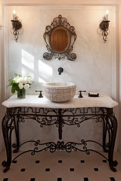 A Spanish romantic-style bathroom with a vanity made of an antique stone basin and custom wrought iron details. Too busy but like the idea of the iron base with antique sink. Decor, Spanish Style Bathrooms, Bathroom Styling, Iron Furniture, French Country Bathroom, Mediterranean Home Decor, Bathroom Design, Iron Decor, Beautiful Bathrooms