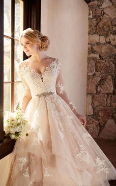 This elegantly crafted designer tulle wedding dress from Essense of Australia features alluring illusion lace sleeves and eye-catching cuts of tulle on its skirt. Essense of Australia, Fall 2016 Lace Wedding Dress With Sleeves, Applique Wedding Dress, Long Sleeve Wedding, Fall Wedding Dresses, Perfect Wedding Dress, Tulle Wedding, Bridal Dresses, Lace Sleeves, Dream Wedding