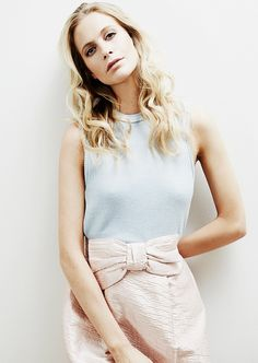 Poppy Delevingne talks about her style icon,  Jane Birkin // wearing a pastel blue tank and bow-front skirt