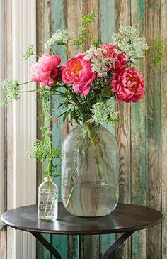Place peonies and Queen Anne's lace inside a recycled jug for a rustic chic effect, @countryliving tells us. Perfect centerpiece for a romantic setting...   Love, Grandin Road