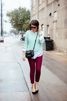 Light mint green lightweight boatneck sweater over untucked white button down shirt and cranberry skinny pants above ankle