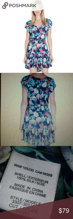 Joie Belinda dress in dark navy floral NWT Beautiful silk floral dress with a slight high low hem. perfect for spring/summer!  Includes elastic adjustable belt. Joie Dresses