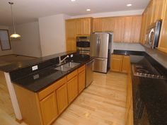 Fabulous Open Kitchen with Black Granite Countertops and Stainless Steel Appliances