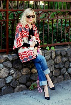Fun pattern & color on a poncho with jeans and heels. Such a great look.