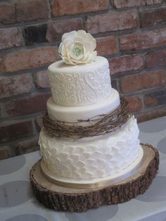 Inspiration for the top layers of Piper's wedding cake?!? Include the silver ribbon to tie in the silver trays holding the extra cupcakes not on the bottom wooden tiers.