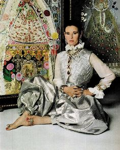 Gloria Vanderbilt combines Adolfo's lame vest and harem pants with a ruffled shirt from an English boutique. 1968