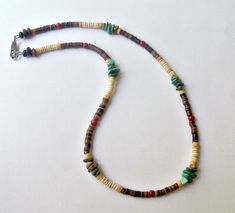 This Native American beaded necklace is designed with rich golden brown shell, green turquoise, and antique bone. I named this a snake necklace because the ribbed beads in the shell remind me of snake