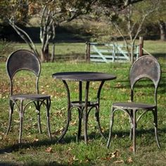 Distressed Black Patio Table And Chairs 1