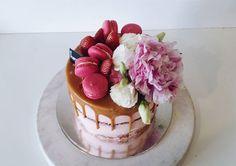 Blush pink naked cake with caramel drip, macarons, berries & blooms Cake flavour banana cake with salted caramel filling