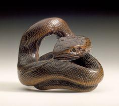 Hokkyo Sessai (Japan, 1820 - 1879)   Snake, mid-19th century  Netsuke, Wood with inlays
