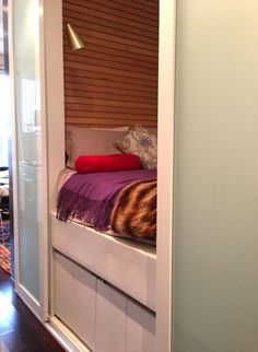 A bed hidden in plain sight in a studio apartment. Great for lofts too.