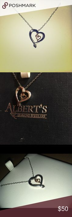 Necklace Silver outer heart with a smaller rose gold heart in between, with a little diamond in the center. Albert's Diamond Jewelers Jewelry Necklaces