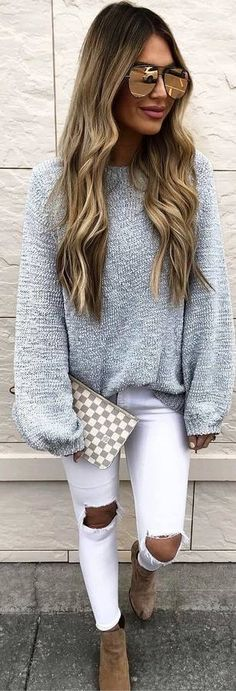 grey sweater, ripped white jeans, brown boots