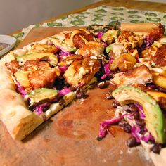 #PizzaTuesday Cinco de Mayo #Pizza: Crumbled queso fresco, black beans, shredded red cabbage, beer-battered fried tilapia, avocado, fried plantains (in coconut oil), sriracha mayo drizzle, lime juice