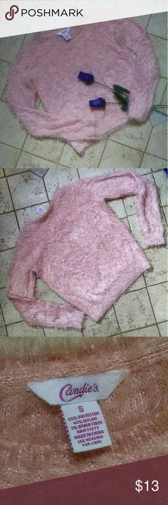 Clueless fuzzy pink sugar sweater! Complete your Clueless outfit with this fuzzy sweater! So cute and comfortable! Pair it with a pleated skirt some white knee high socks and a fuzzy backpack and you can call yourself Cher! Only one mark of sleeve. I believe it is makeup and after one wash nearly disappeared. See last picture Candie's Sweaters Crew & Scoop Necks