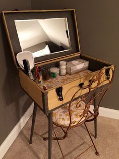 DIY antique suitcase repurposed as a vanity for my guest room. Tin suitcase more than 50 years old, yellow and gray, vintage.