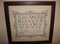 Sampler Cross Stitch done by Ginny Graham..