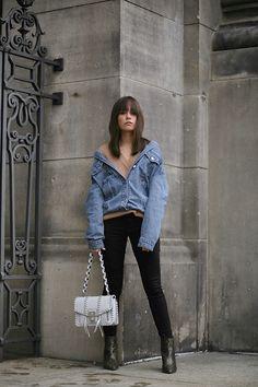 Nisi is wearing: Denim Jacket alla Balenciaga, Proenza Shoulder Hava bag, Python print boots, Cornelia Webb Earrings, Nude sweater, Black skinny jeans - teetharejade.com