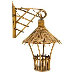 Small Rattan Sconce | From a unique collection of antique and modern wall lights and sconces at https://www.1stdibs.com/furniture/lighting/sconces-wall-lights/