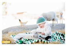 My sweet niece Vie and a 6 day old lamb. We took the maternity photos on this farm with baby lambs almost a year ago to this day so we thought it appropriate to go back for 9 month photos since she LOVES animals. She smiled the entire time!