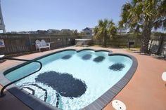 """Doggy paw shaped pool at """"Happy Dog Days"""" #1112 with Beach Realty / Kitty Hawk Rentals http://www.beachrealtync.com/rental/house.html?ID=818 #petfriendly #obx #outerbanks #dogswelcome #vacationhome"""