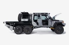 In 2016 Patriot Campers took the world by storm with the release of their Supertourer dubbed the Black Truck, a highly-customizable, imminently-capable off-road machine based on the new GXL Toyota Landcruiser dual cab. 6x6 Truck, Jeep Truck, Truck Camper, Motorcycle Camping, Camping Gear, Carros Toyota, Black Truck, Pick Up, Trailers
