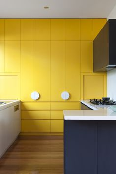 Yellow cupboards and round handles | Doherty Lynch