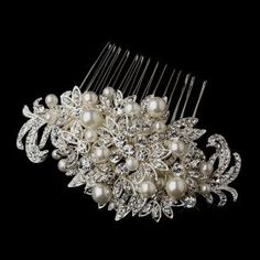 Fabulous swirling vine and leaf silver plating encrusted with glittering clear crystals and adorned with luminous white faux pearls sit atop this stunning bridal hair comb.