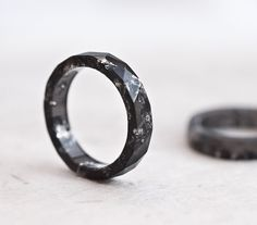 This small subtle black faceted ring is made from bio based eco-resin. The ring contains sparkled silver flakes. This resin ring is stackable. My resin