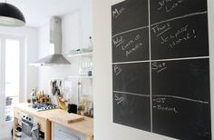 chalkboard on door is great, love how airy the kitchen is