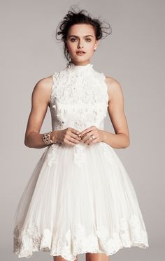 The way the high collar beautifully accentuates her arms. | 51 Beautiful City Hall Wedding Dress Details You'll Swoon Over