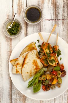 Baked eggplant salad with grilled halloumi skewers