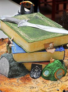 "A stack of books and other objects depicting J.R.R. Tolkien's ""Lord of the Rings"" trilogy, one of a variety of book-themed creations in the WV Book Faire's edible books competition 2011"