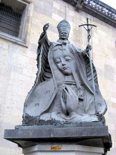 A statue of Pope St. John Paul II with an image of Our Lady of Guadalupe, near the Metropolitan Cathedral in Mexico City.