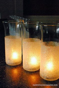 Glittering glass containers add to a Christmas glow.