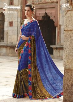 Stylish half foil print blue georgette and half brown crape jacquard saree define the fusion of fabric & colors.