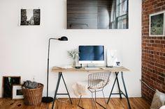 Madelynn's fabulous industrial style loft. Black and teak = industrial whereas white and teak = Scandinavian